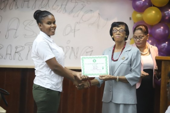 One of the officers receiving her certificate from Patricia David of the Carnegie School of Home Economics