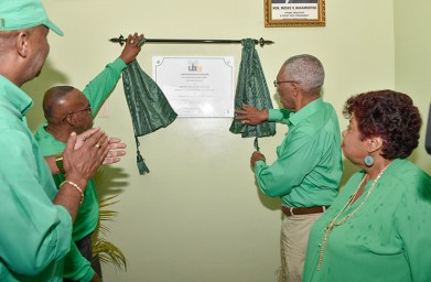 President David Granger (right) and Regional Chairman (Region 10) Rennis Morian unveil a plaque at the Linden Broadcasting Network. Also in photo are Minister of Social Protection, Ms. Amna Ally (left of President Granger) and Director-General, Ministry of the Presidency, Mr. Joseph Harmon (left)