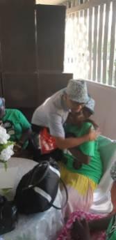 Mayor of Georgetown, Pandit Ubraj Narine embraces a senior resident of Buxton