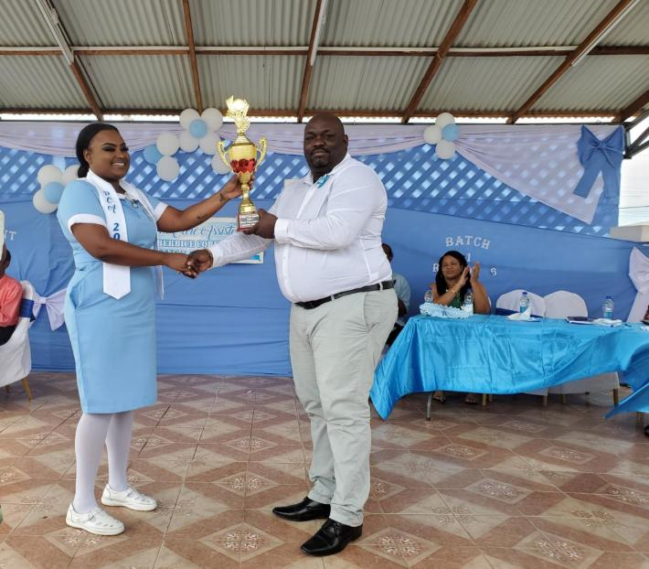 One of two valedictorians, Ayana George receiving her award from Director of Regional Health Services Region Six, Jevaughn Andrew-Stephen