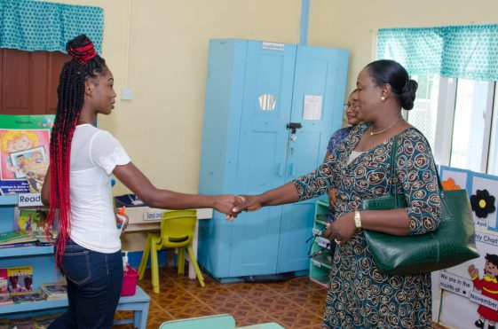 Minister of Education Dr. Nicolette Henry Greeting teachers at Turkeyen Nursery School
