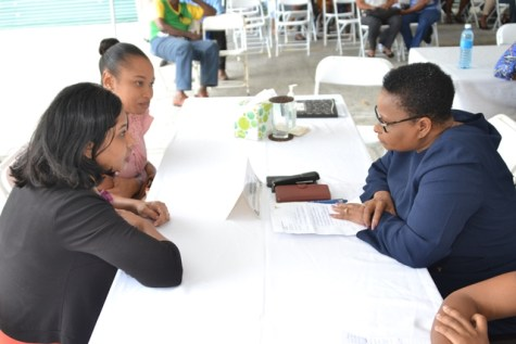 Minister Lawrence interacts with Persons during the Public Day hosted by the Health Ministry.