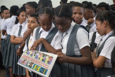 Two Linden Foundation Secondary School students reading 'Education Nation'.