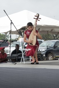 A representative from the Chinese playing the mandolin.
