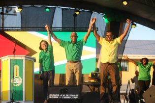 First lady Sandra Granger, President David Granger and Prime Ministerial and Public Security Minister Khemraj Ramjattan on stage at the Golden Grove Community Ground Rally on the East Coast of Demerara