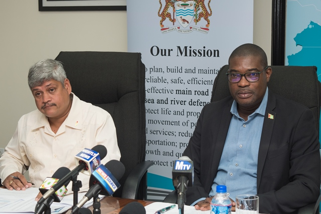 Minister of Public Infrastructure, Hon. David Patterson and Minister within the ministry, Hon. Jaipaul Sharma.