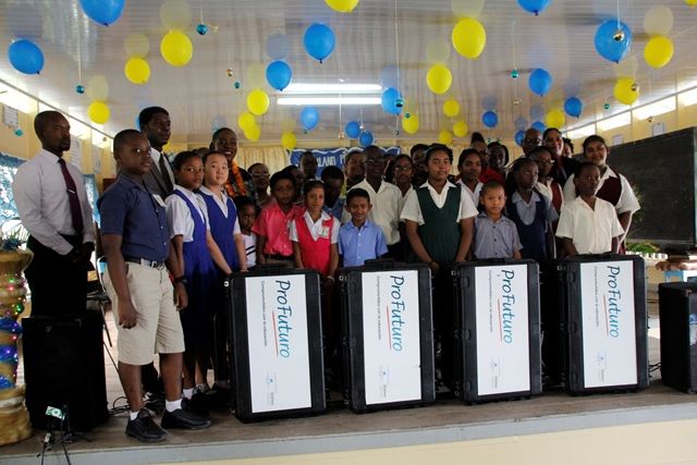 Some of the East Berbice-Corentyne students along with the Minister of Education Dr Nicolette Henry, OAS Representative Ricot Dormeus and other officials, following the presentation of the ProFuturo' digital learning kits and electronic tablets.