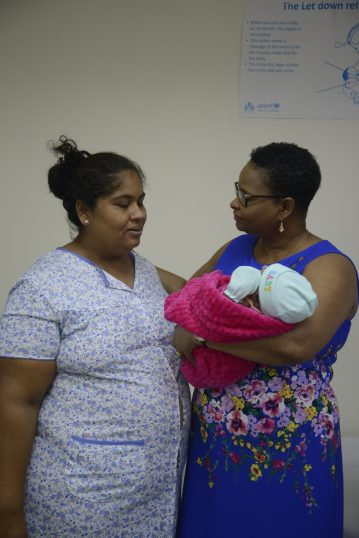 Minister of Public Health, Volda Lawrence sharing a light moment with Thalia and her mother Casindra Dorsett