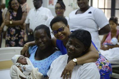 Minister of Public Health, Volda Lawrence with Keshanna Pollard and her baby boy and a staff of the GPHC