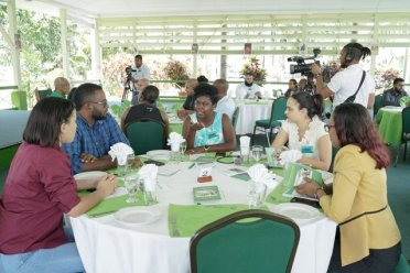 Members and Volunteers of Heal Guyana during a round table discussion held at the Baridi Benab, this afternoon. President David Granger is also pictured left (background).