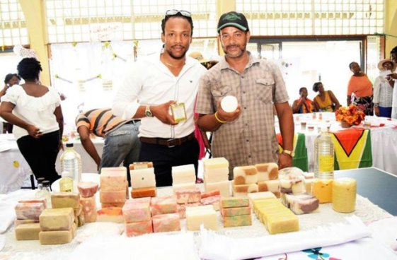 Linden farmer and agro-processor Owen-DeSouza alsong with MP Jermaine Figuerai proudly displays some of his locally produced soaps.