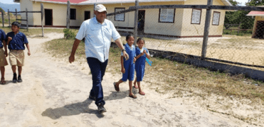 The Minister conducting a walk with students of the Primary School.