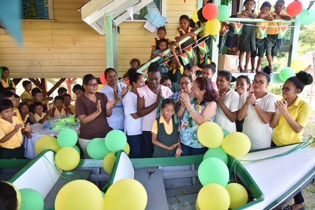 Minister of State, Hon. Dawn Hastings-Williams handing over the boat to the village leaders.