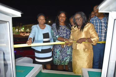 From Left to right, Minister of Public Health Volda Lawrence, Deputy Permanent Secretary-Admin MoPH, Shellon Bess and Permanent Secretary, Collette Adams cut the ceremonial ribbon to commission the boat with other staff of the ministry watching on