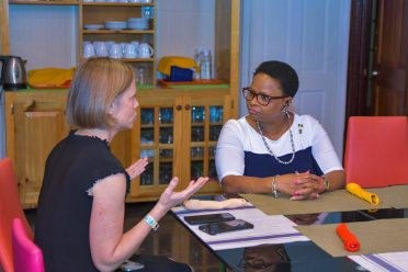 Gillian Battino, MD interacts with Public Health Minister, Volda Lawrence