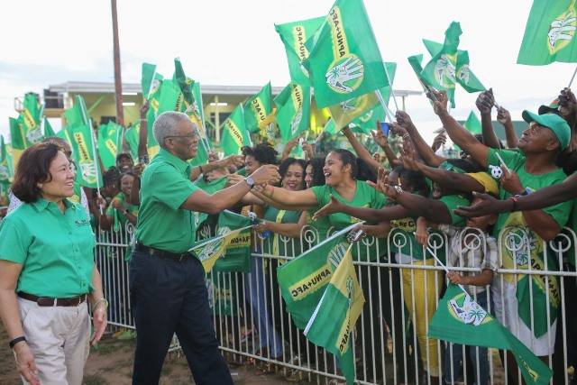 H.E President David Granger, accompanied by First Lady Mrs. Sandra Granger, greets young supports in Bartica, He is interacting with youths of Bartica.