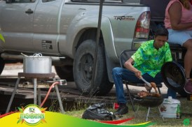 Deep concentration as he grills his chicken.
