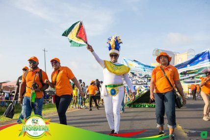 Proudly waving the Golden Arrowhead Minister within the Ministry of Communities, Hon. Annette Ferguson lead the Central Housing and Planning band along Carifesta Avenue.