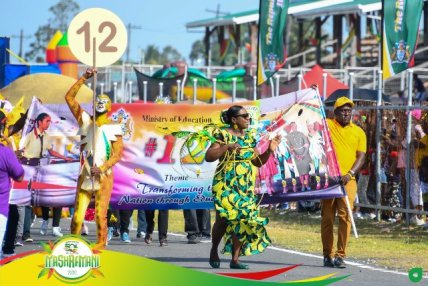 Minister of Education Dr. the Hon. Nicolette Henry leading her band into D'Urban Park.