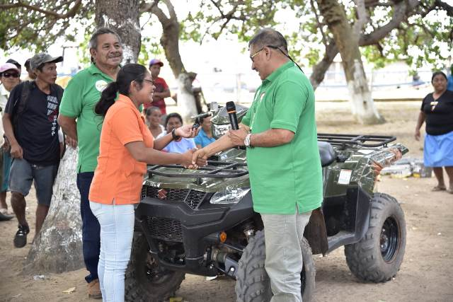 Minister of Indigenous Peoples' Affairs, Hon. Sydney Allicock handing over the keys to the ATV to the Community Development Officer.