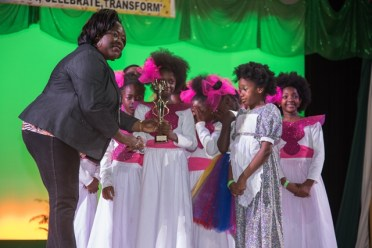 Plea for a father's Love dancers receive their Third-place trophy in the 8-10 category.