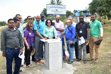 First lady mrs. Sandra Granger unveiling the plaque in the presence of Minister Bulkan, Dr. Van West-Charles and other officials.