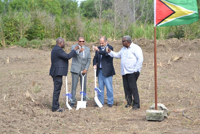 Chief Executive Officer (acting) of NICIL Colvin Heath-London, Minister of Business Haimraj Rajkumar, Head of Trinuyana Investments Incorporated of Guyana John Aboud and President of the Guyana Manufacturers and Services Association Clinton Williams toast after turning the sod for the proposed AC Marriot Hotel at Ogle.