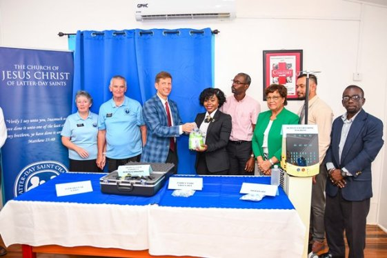 Representatives of the Church of Jesus Christ of Latter-Day Saints hand over the equipment to representative from the Department of Ophthalmology, while CEO, GPHC, Brigadier George Lewis (ret'd) (right) and Deputy Permanent Secretary of the Ministry of Public Health, Glendon Fogenay and other hospital officials look on.