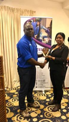 Director of National Blood Transfusion Service, Dr. Pedro Lewis, recognising a Phlebotomist for her service for over 10 years.