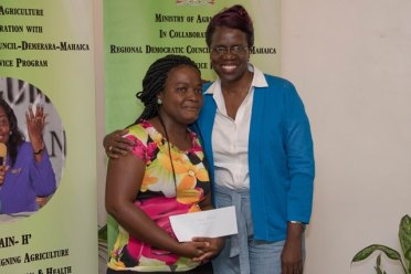 Region 6, second prize winner, Mabuba Muhammad after receiving her prize from Permanent Secretary of the Ministry of Agriculture, Delma Nedd.