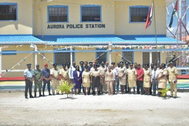 Minister of Public Security Hon. Khemraj Ramjattan, Commissioner of Police, Leslie James Attendees along with members of the Guyana Police Force and other officials in front of the rehabilitated Aurora Police Station.