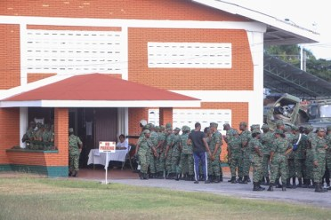 Members of the Guyana Defence Force queuing to cast their ballots at GDF Base Camp Ayanganna.