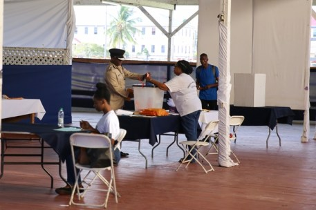 Commissioner of Police Leslie James casting his ballot.