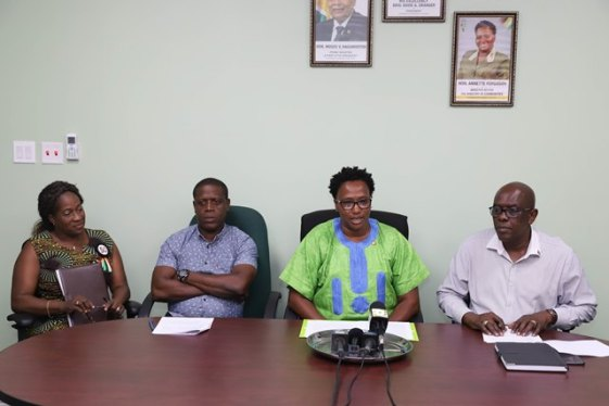 Top-level management of the CH&PA, from left to right, Director of Operations, Denise King-Tudor, Chief Executive Officer, Lelon Saul, Minister within the Ministry of Communities Annette Ferguson and Technical Assistant to Minister Ferguson, Remington Nelson.
