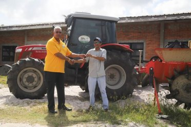 Minister Holder handed over tractor and implements valued at $15.5M to the Hope Coconut Industries Limited (HCIL).