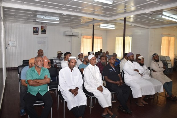 Some of the members of the Muslim community in Corriverton during the meeting with Minister Amna Ally.