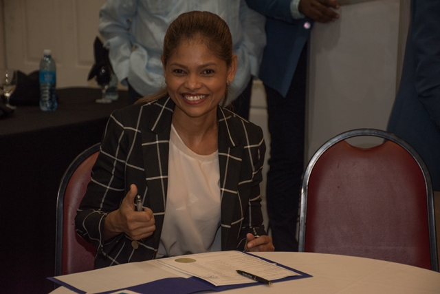 Mishka Puran, Prime Ministerial Candidate for Change Guyana signing the Code of Conduct.