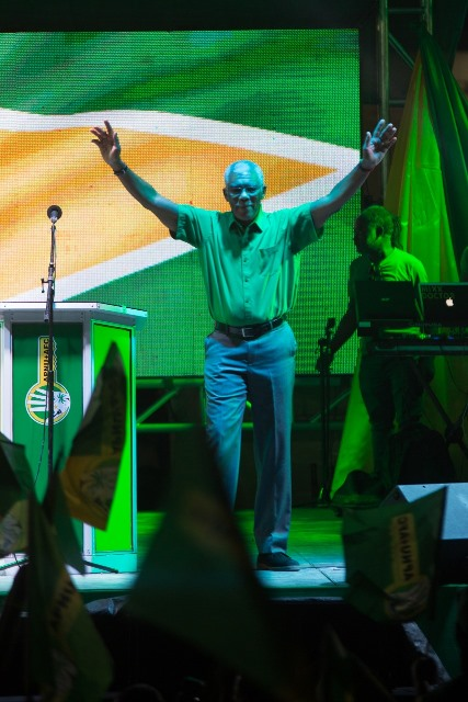 HE President David Granger acknowledges the crowd as he walks onto the stage at the rally in Bayroc, Wismar Linden.