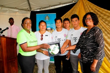Minister Henry and Administrator of the Unit for Allied Arts, Ms. Lorraine Barker-King handing-over items to the Desrey Fox-Caesar Secondary School.