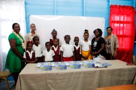 Minister Henry and Regional Education Officer, Mrs. La Cruz pose for a photograph with students and teachers of the Gibraltar Courtland Primary School.