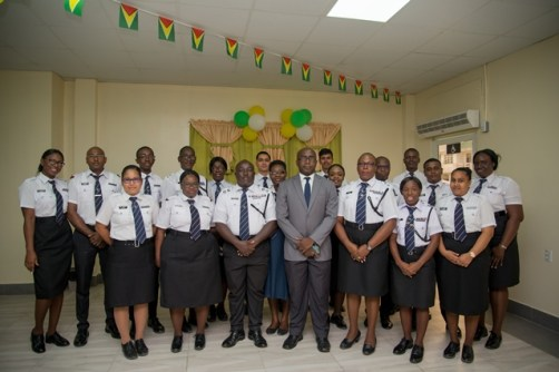 Deputy-Chief Immigration Officer Ewart Wray, (in grey jacket) along with Assistant Superintendent Fiona Harris (front row third from right)and members of staff of the Berbice Immigration and Passport.