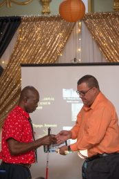 Visually impaired Lawrence Braithwaite of Braf's Manufacturing receiving his award for the Most Inspirational small business
