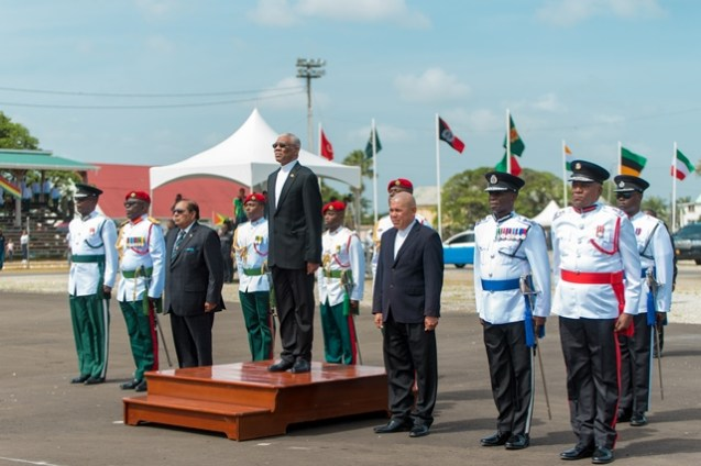 H.E David Granger flanked by Prime Minister, Hon Moses Nagamootoo and Minister of Social Cohesion Dr. George Norton taking the salute.