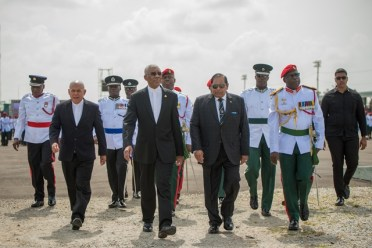 H.E David Granger flanked by Prime Minister, Hon Moses Nagamootoo and Minister of Social Cohesion Dr. George Norton about to inspect the Guard of Honour.