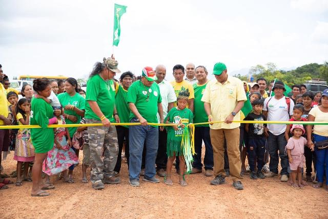 Priya Leonard of Hiawa Village cutting the ribbon in the presence of Minister of Indigenous Peoples' Affairs, Sydney Allicock and Minister of Natural Resources, Raphael Trotman and Ministerial Advisor, Mervyn Williams.
