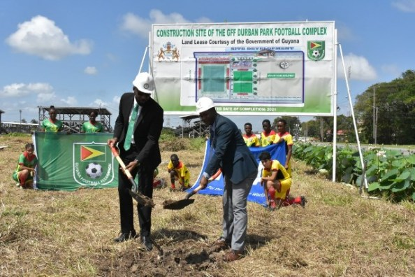 Director of Sport Christopher Jones and GFF President Wayne Forde turn the sod for the construction of the GFF Football Complex at Durban Park.