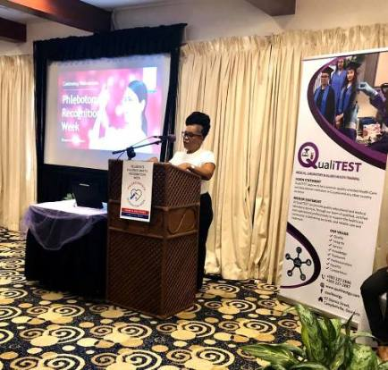 Director of QualiTEST, Ms. Yvette Irving giving opening remarks at recognition event.