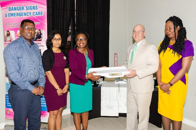 Permanent Secretary at MOPH, Ms. Colette Adams receiving items.