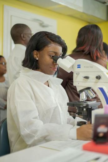 A Medical Technologist of the National Tuberculosis programme examines a sputum sample in the newly established TB testing Lab.