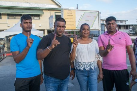 Beterverwagting resident, Chitram Persaud, along with his wife and sons after casting their votes at the Beterverwagting Secondary School, ECD.